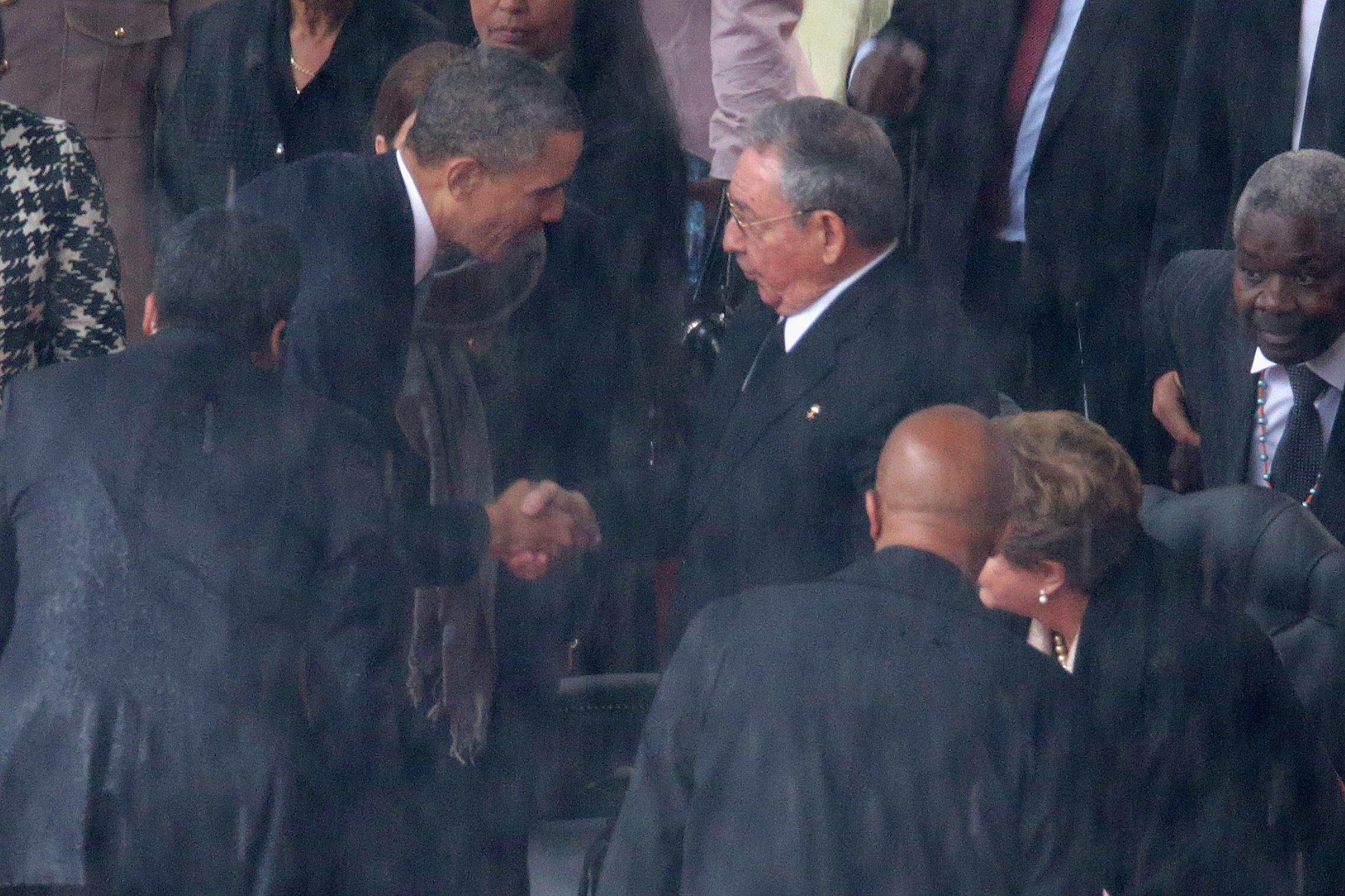 Obama Meets Raul Castro at Mandela Memorial